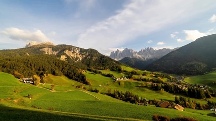 Fototapete - Time lapse of Santa Maddalena village with majestic Dolomite mountains in background, Val di Funes valley, Trentino Alto Adige region, Italy, Europe.