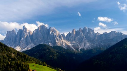 Fototapete - Time lapse of Santa Magdalena village hills in front of the Geisler or Odle Dolomites Group. Colorful autumn scene of Dolomite Alps, Italy, Europe.