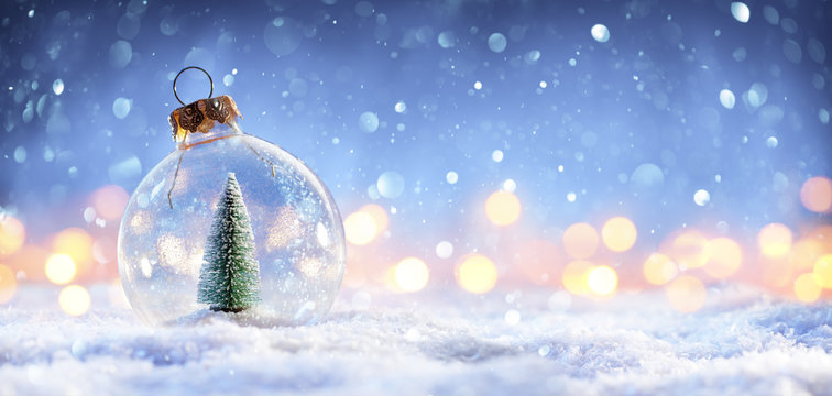 Snow Ball With Christmas Tree In It And Lights On Winter Background