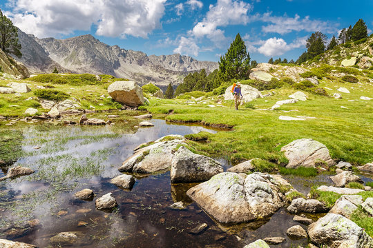 Impressive view of Pyrenees landscape in Andorra, with woman hiker