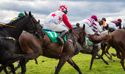 Close-up on fast action horse racing