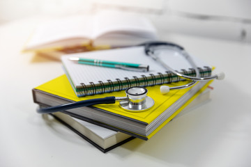 medical education - medicine books and notes on the table