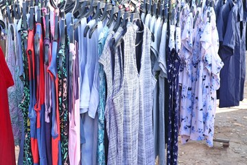 shop clothes for sales at market.