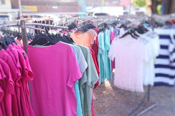 shop clothes for sales at market.
