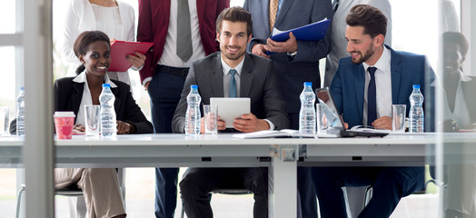 Multiethnic team of employees at table