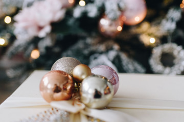 Beautifully wrapped Christmas presents in pink and silver. Concept of Christmas and New Year holidays.
