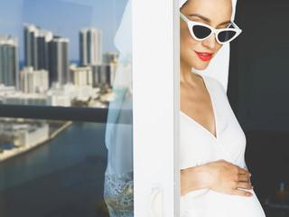 Pregnant woman on balcony