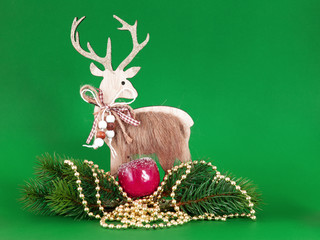 Christmas decoration wooden reindeer with fir twig