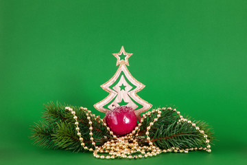 Christmas decoration green background with fir tree and apple