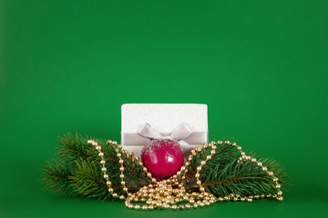 Christmas decoration green background with fir tree and gift box