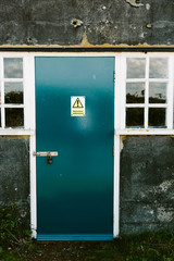 Blue door with a hazardous substances sign on it