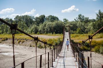 Young woman on footbridge