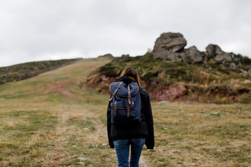 Young woman hiking through mountain