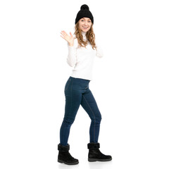 Beautiful woman in sweater jeans hat cold waving her hand on white background isolation back view