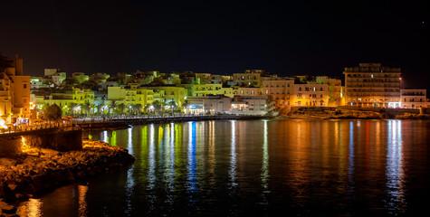 Night view of Vieste - main city of Capo Gargano, Apulia, Italy