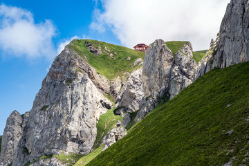 house in solitude on a mountain peak in the bernese oberland, switzerland, europe