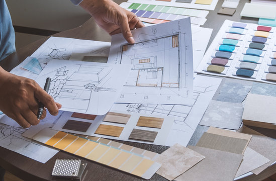 Architect designer Interior creative working hand drawing sketch plan blue print selection material color samples art tools Design Studio