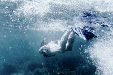 Active woman snorkeling underwater.