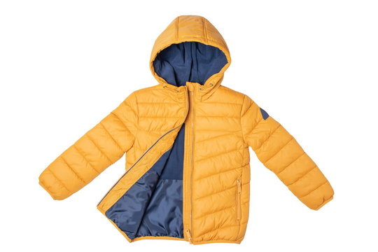 Childrens winter jacket. Stylish childrens yellow warm down jacket isolated on white background. Winter fashion.