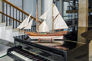 Sailing ship model is on piano