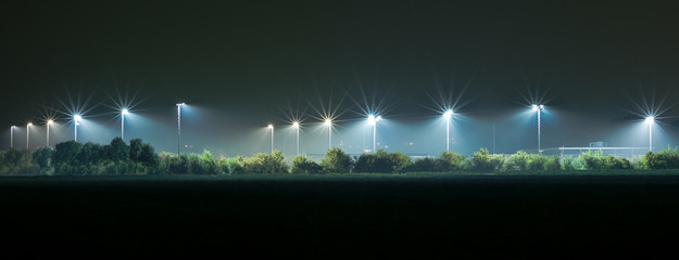 Panoramic view of the lights on a sports field Fotomurales