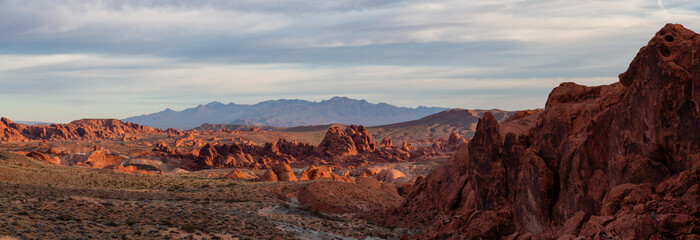 Beautiful panoramic American Landscape during a cloudy sunrise. Taken in Valley of Fire State Park, Nevada, United States.