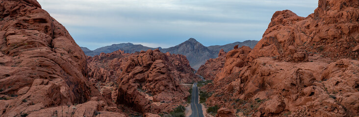 Wall Murals Deep brown Aerial panoramic view on the scenic road in the desert during a cloudy sunrise. Taken in Valley of Fire State Park, Nevada, United States.