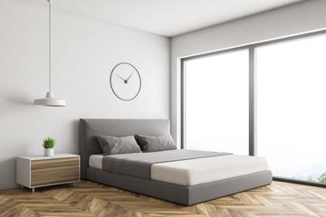 White loft bedroom corner with clock