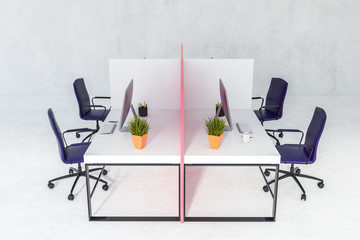 White office tables in concrete room