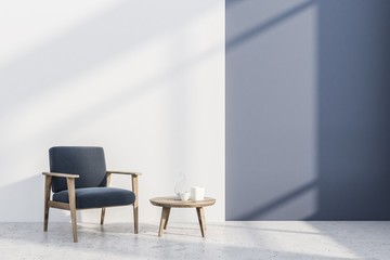 Blue and white room, gray armchair, table