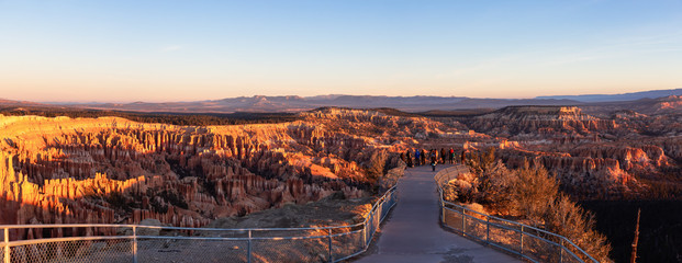 Bryce Canyon National Park, Utah, United States - November 13, 2018: Group of photographers are taking pictures of the beautiful landscape during a vibrant sunrise.
