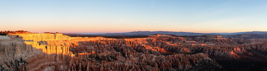 Aerial panoramic view of the beautiful American Canyon Landscape during a vibrant sunrise. Taken in Bryce Canyon National Park, Utah, United States