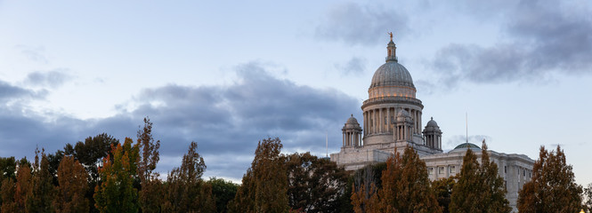 Panoramic view of Rhode Island State House during a vibrant sunset. Located in Downtown Providence, Rhode Island, United States.