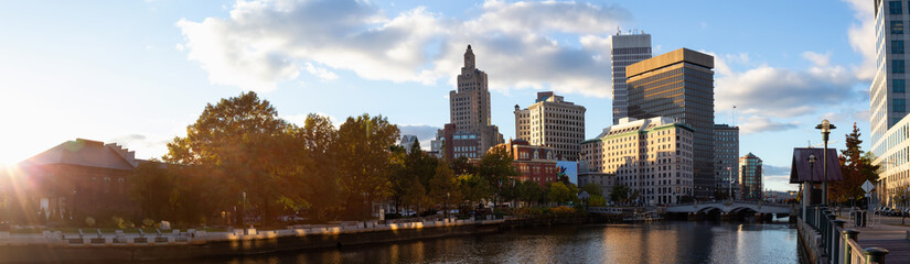 Panoramic view of a beautiful modern city during a vibrant sunset. Taken in Downtown Providence, Rhode Island, United States.