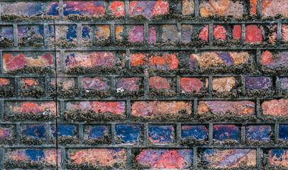 Multi coloured old brick wall