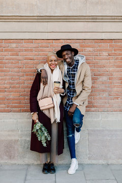 Portrait of cool couple on the street in winter. City lovers.