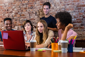 team working on laptop during meeting