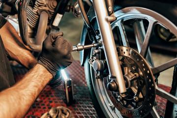 Mechanic working in the motorbike workshop