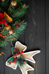 Christmas decorations on a black wooden background
