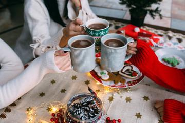 Female friends drinking hot chocolate