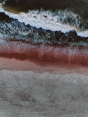 Aerial view of a red and white sand beach