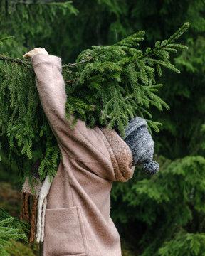 Woman holding fir tree branch