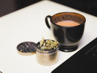 Cannabis Flower in Grinder Near Coffee