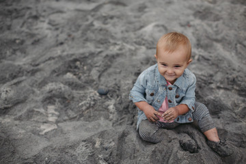 Dirty sandy toddler at the beach