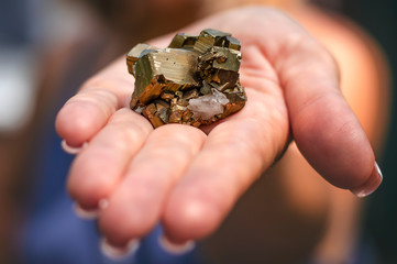pyrite, rock in the female hand