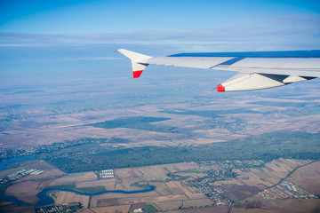Window view of flying over the Romanian countryside after taking off from Bucharest, Romania