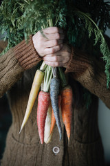 Woman holding carrot