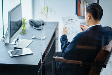 Business man review his resume on his office,Seleted focus.