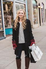 A teenage girl shopping at christmastime