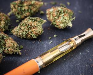 One Gram THC/CBD Cannabis oil filled vape pen with marijuana buds up close